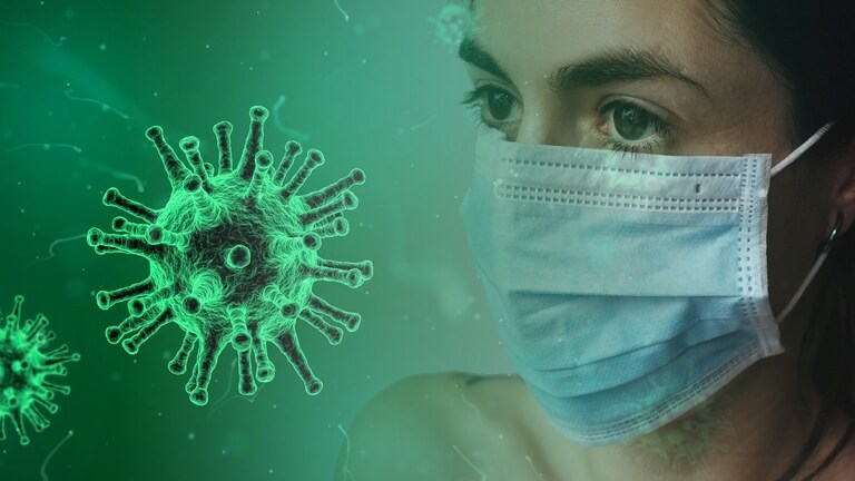 News and Events Value image, showing Nurse wearing mask and contemplating coronavirus